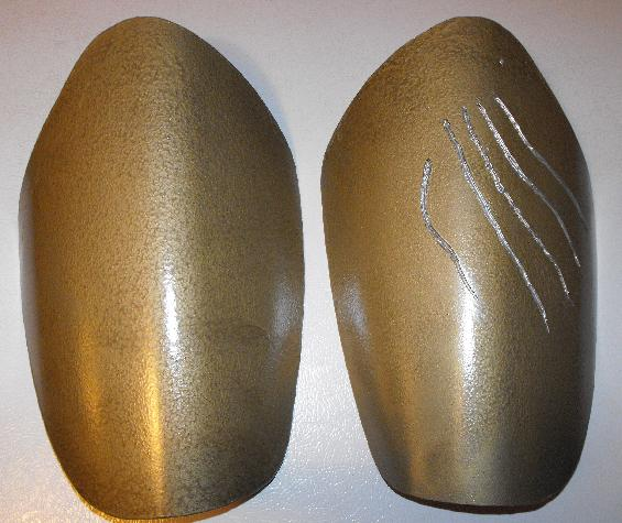thigh pads of armor cut from plastic trash can based on